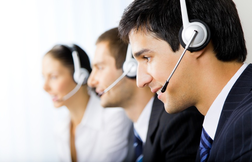 Three support phone operators at workplace